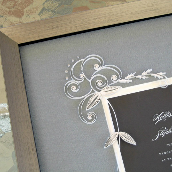 quilled wedding invitation with white floral design and gray mat