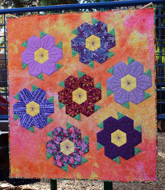 Saw Tooth Flowers by QuiltFabrication - for sale