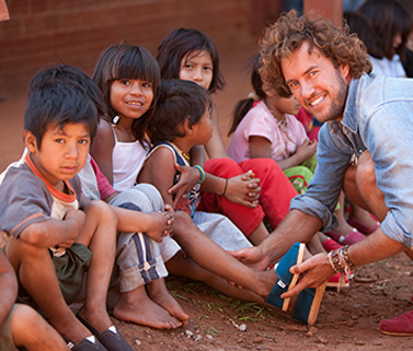 d3ed4e34507 Fig 1  TOMS (N A) Blake Mycoskie providing children with TOM s footwear   Online Image  Available from  http   www.toms.co.uk improving-lives   Accessed ...