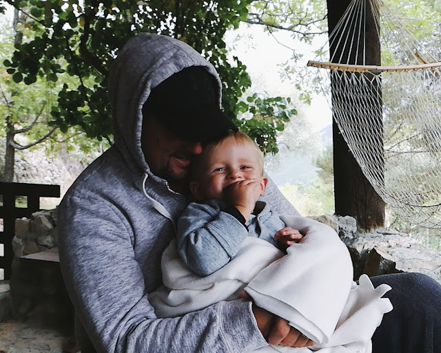Father and son cuddling and laughing