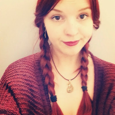 red haired girl with plaits
