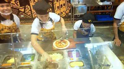 Making your own pizza at Pizza Republic by Giuseppe Genco