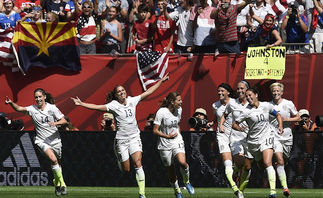 Carli Lloyd (10) celebrates a goal against Japan