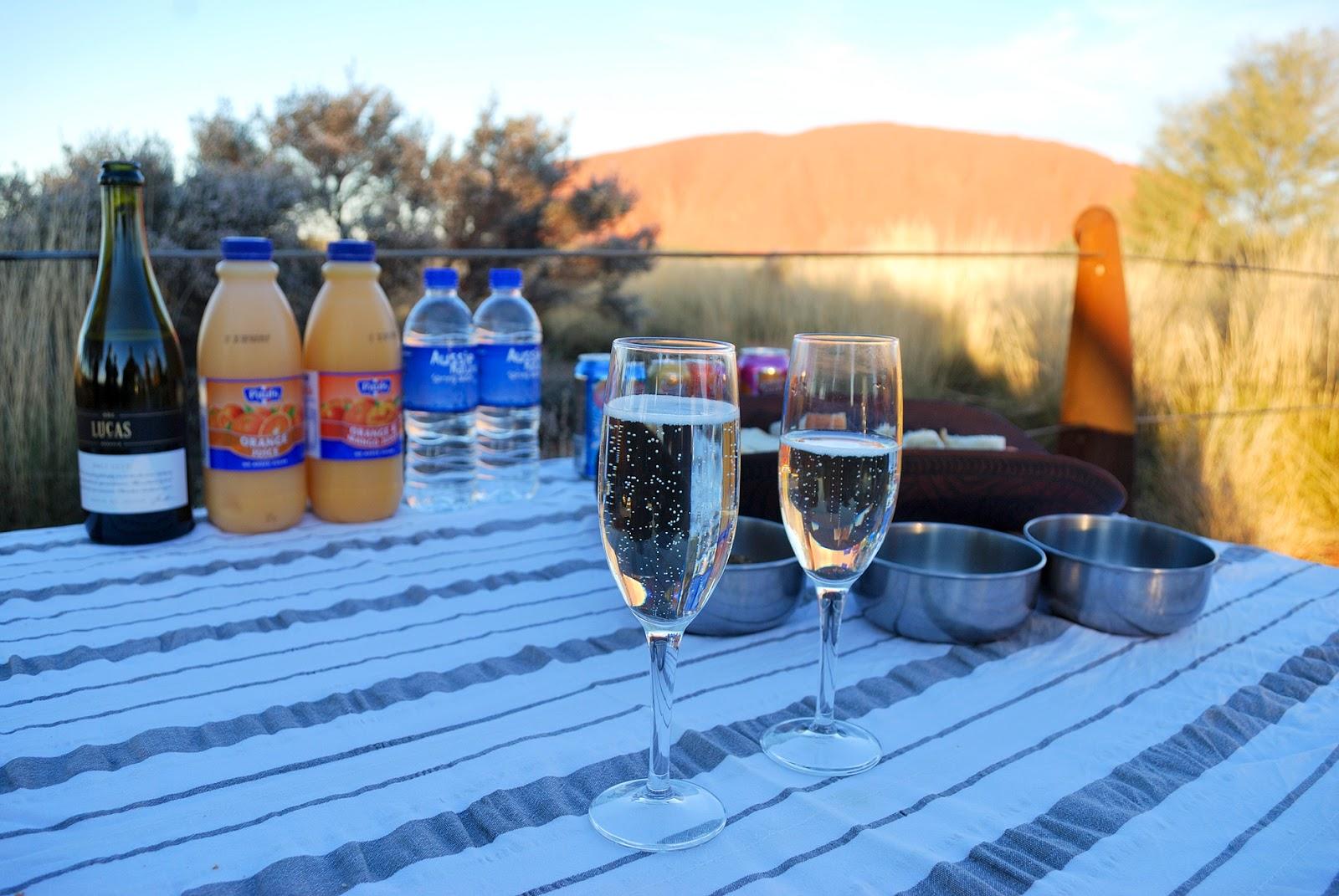 uluru australia sunset champagne picnic