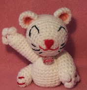 http://www.ravelry.com/patterns/library/crocheted-maneki-neko-lucky-cat