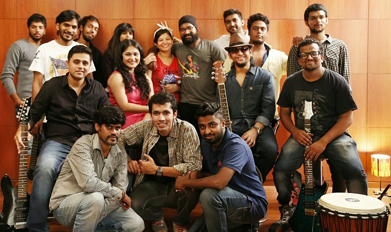 The 'Xaare Aasu' cast and crew members with the photographers