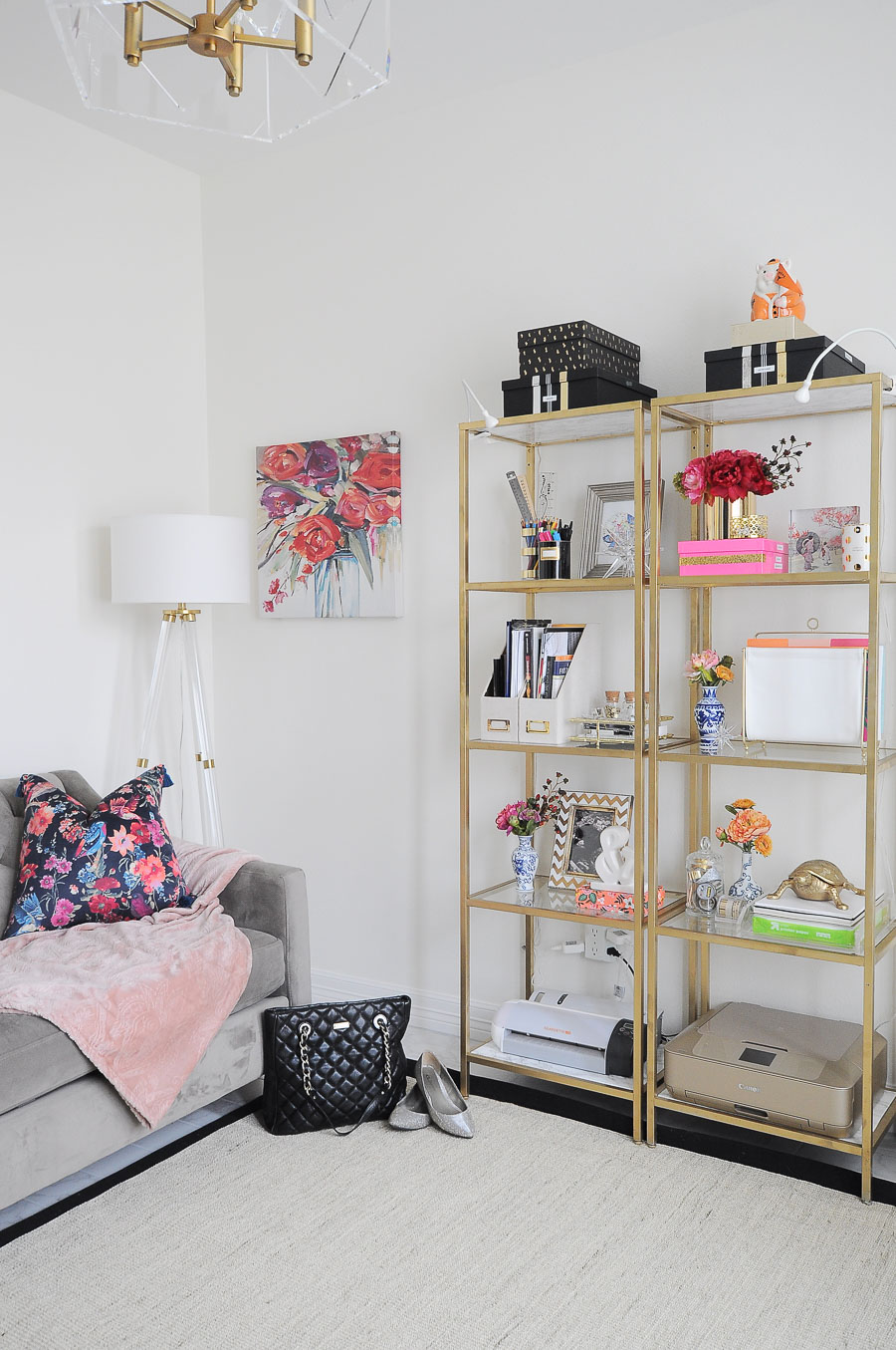 Bright white and gold feminine home office with IKEA vittsjo shelves.