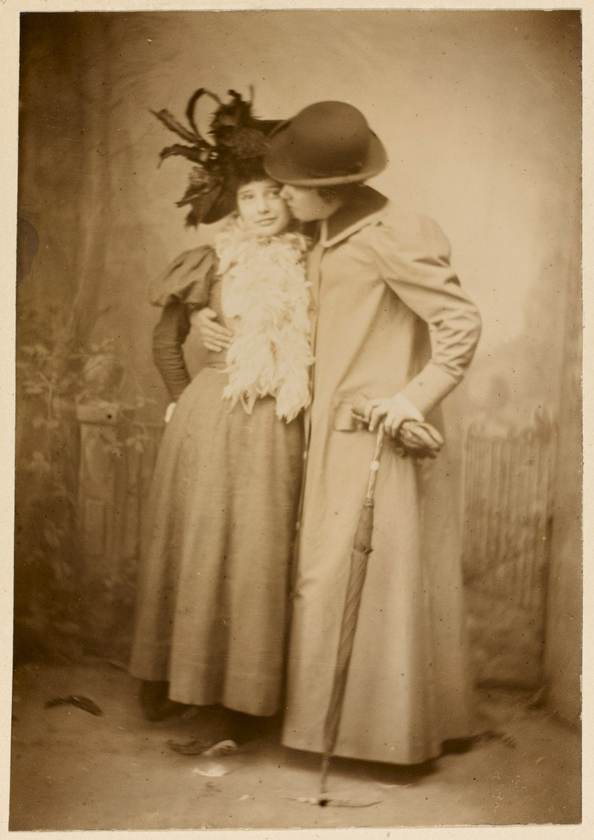 Two Victorian ladies. Kiss on the cheek. Frighten the Horses. marchmatron.com