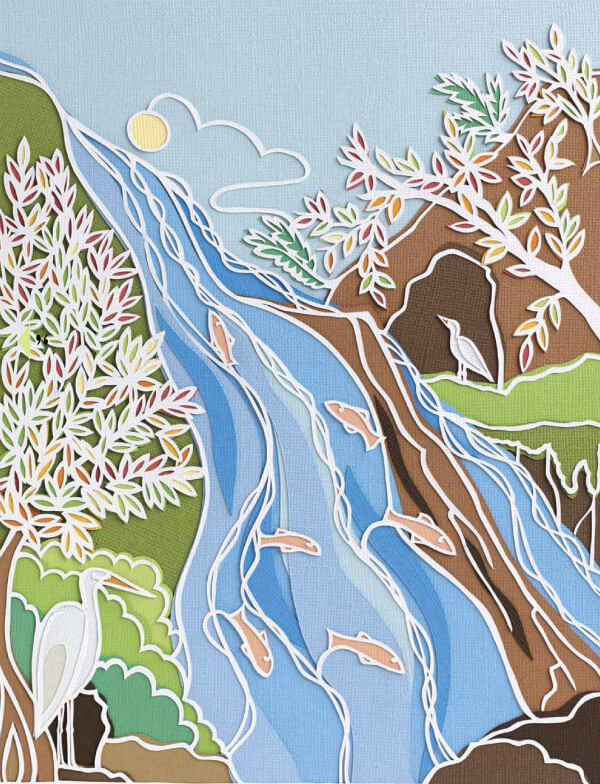layered papercut scene of waterfall with jumping fish