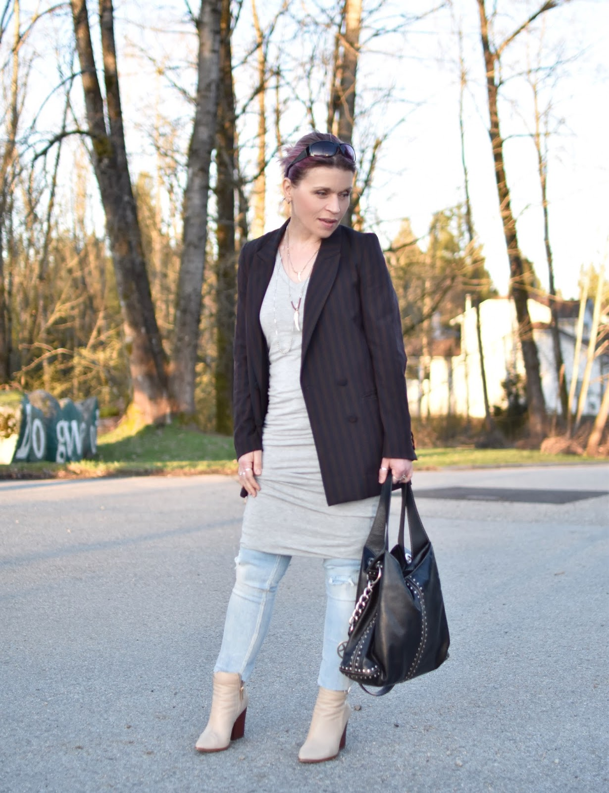 Monika Faulkner outfit inspiration - styling a jersey tank dress over distressed skinny jeans, with a slouchy suit jacket and ivory booties