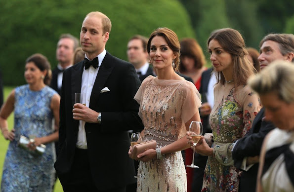 Prince William and Kate Middleton attended a gala charity dinner in support of East Anglia's Children's Hospices. Kate wore Jenny Packham gown