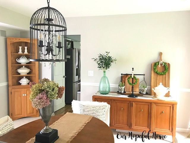 farmhouse dining room sideboard ironstone demijohn olive branches balance scale olive buckets cutting boards boxwood wreaths