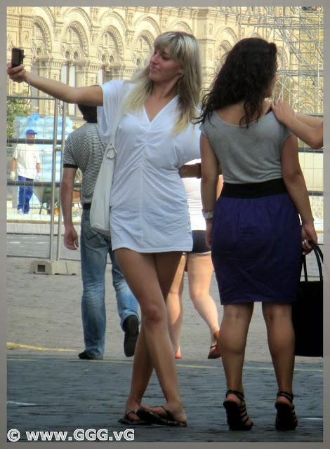 Blonde girl in white shirt on the street