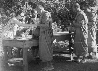 Jane Browne offering dana (meal) to Luang Ta Maha Boowa, Wat Pah Baan Taad, Thailand, 1972