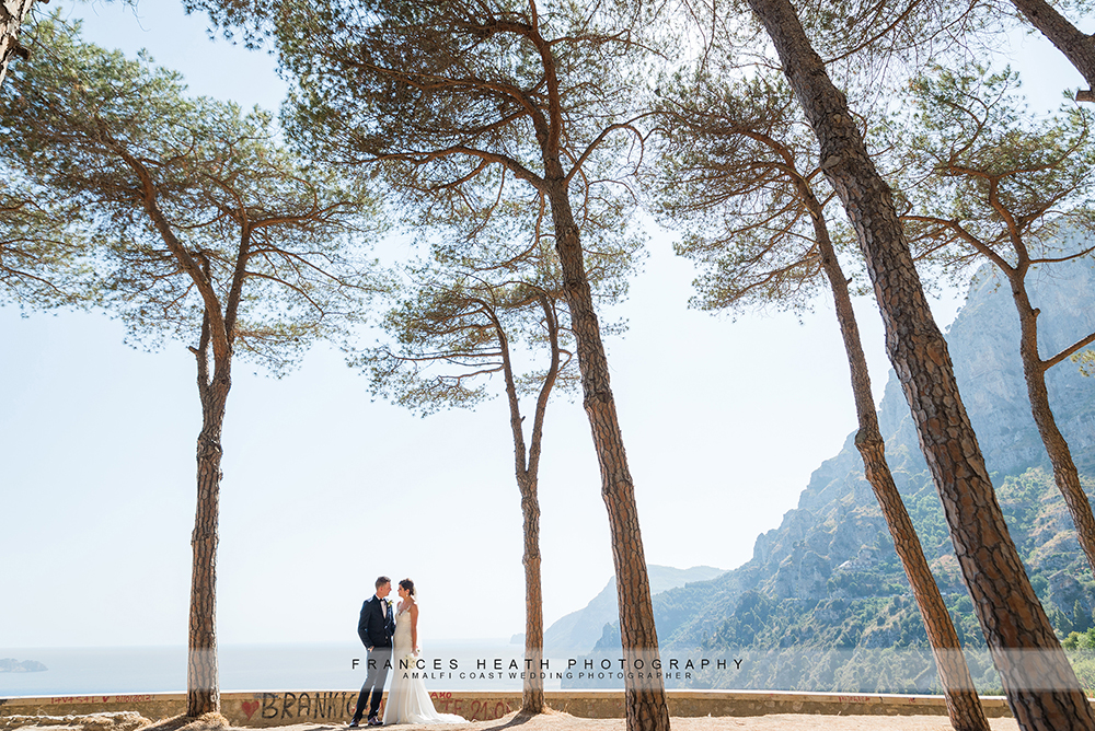 Bride and groom in pine forest in Positano