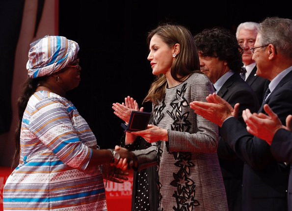 Queen Letizia wore Carolina Herrera Prince Of Wales Floral Cutout Dress. Letizia wore Magrit pumps at Red Cross Day event