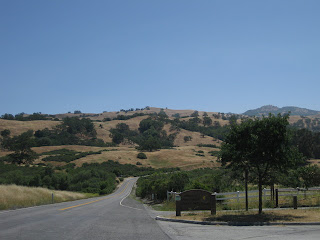 Mt. Hamilton Road climbing past entrance to Joseph D. Grant County Park, with Lick Observatory in the distance