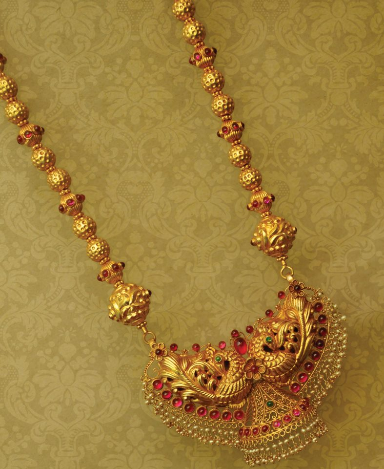 Indian Jewellery and Clothing Beautifully crafted gold temple jewellery studded with rubies and