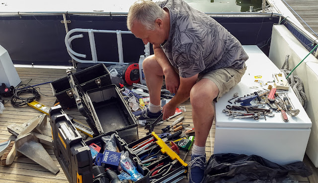 Photo of sorting through our old tools