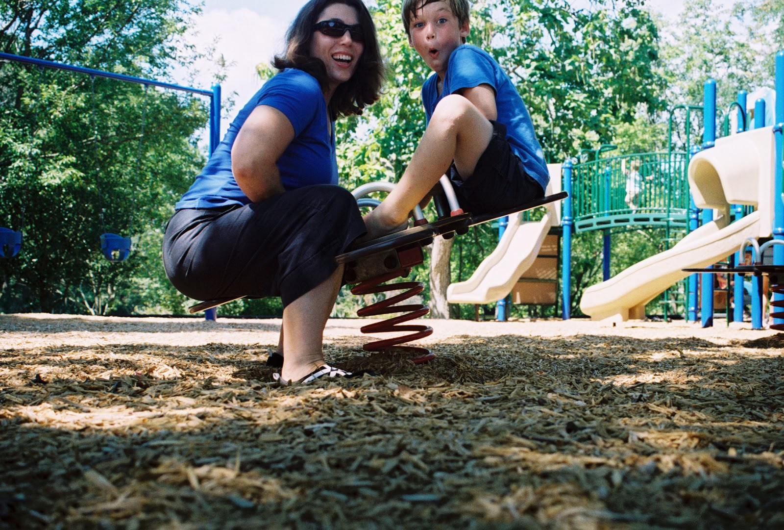 Author and son on teeter-totter ©Diana Sherblom Photography