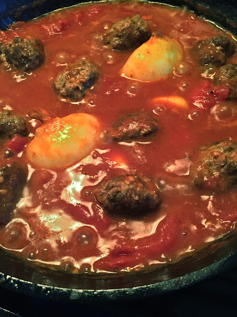 meatballs simmering with San Marzano tomatoes and onions