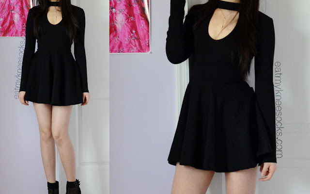 Full outfit featuring the WalkTrendy black mock-neck skater dress, black wedge booties, and a quartz TeaCupCastle necklace.