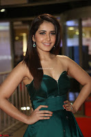 Raashi Khanna in Dark Green Sleeveless Strapless Deep neck Gown at 64th Jio Filmfare Awards South ~  Exclusive 110.JPG