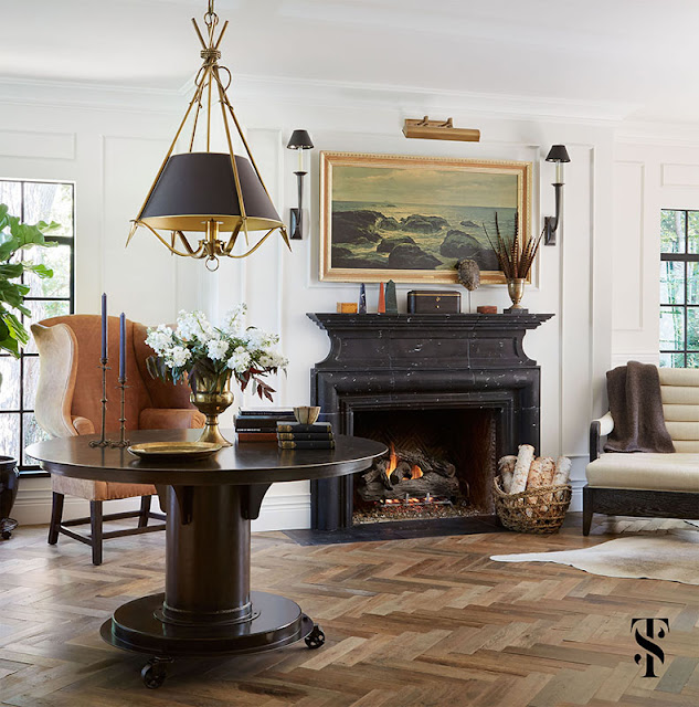 Classic Decor in living room with herringbone wood floor in French Tudor Renovation by Summer Thornton