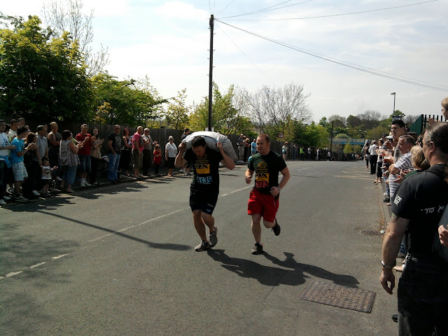 Runners carrying sacks of coal on Easter Monday in Gawthorpe