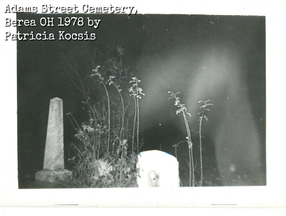 Ghostly image over gravestones