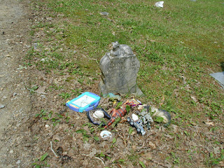 A young child's grave in the cemetery.