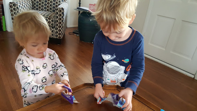 toddlers-opening-presents-chocolates