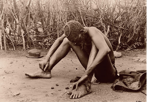 An African man throwing/reading bones.