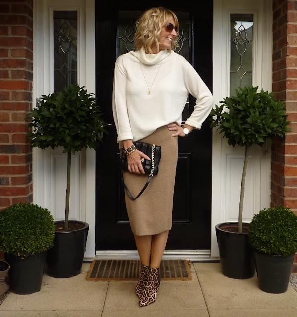 winter white jumper and leopard print boots