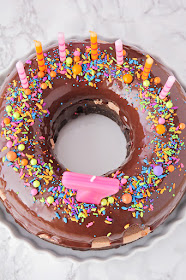 This fun and whimsical chocolate donut birthday cake is so delicious and indulgent!