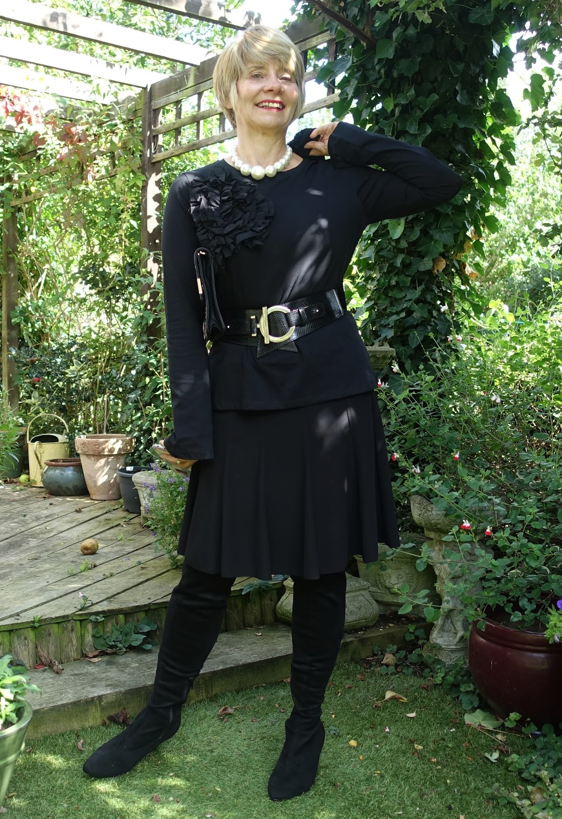 Image showing over 40s blogger Gail Hanlon in all black with a wide leather waist belt and over the knee sock boots