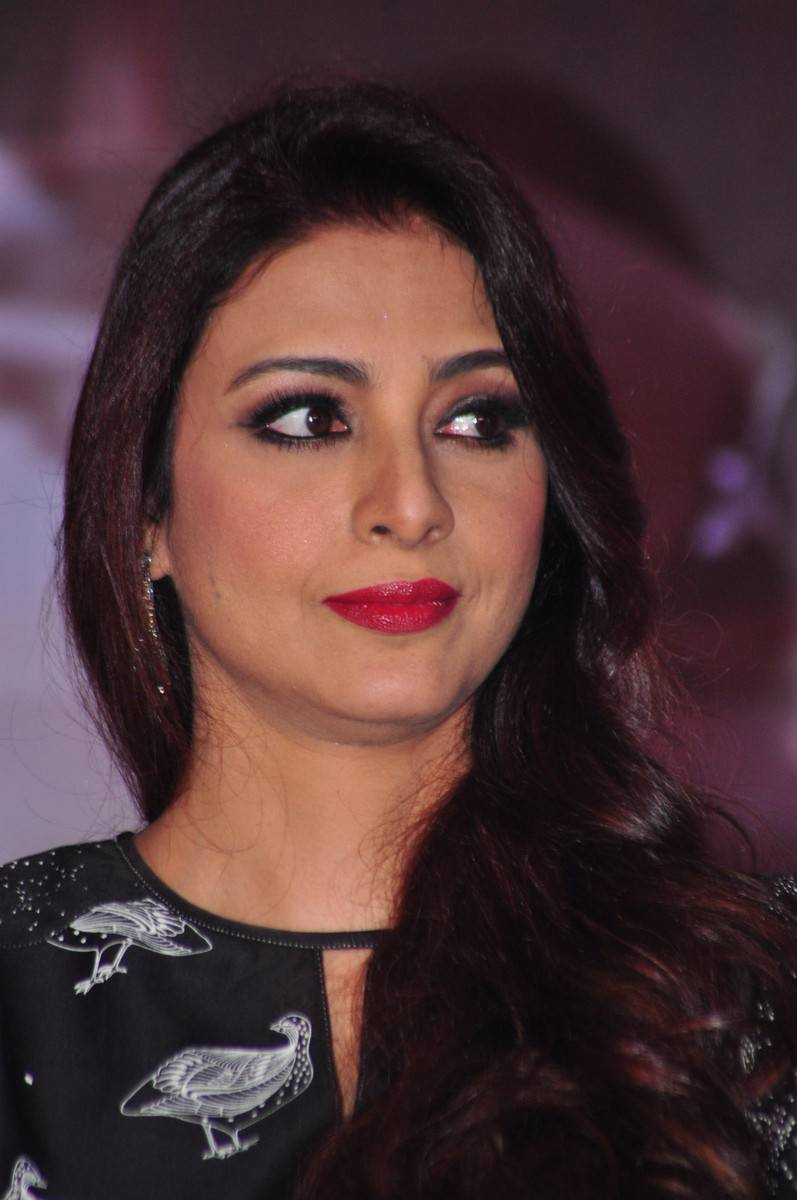 Tabu Latest Hot Stills In Black Dress