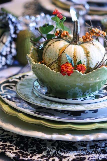 These mini pumpkins on the table setting make it feel autumn like.
