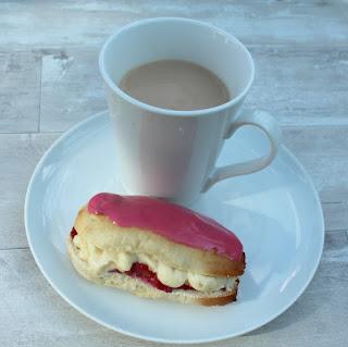 iced bun and a cup of tea