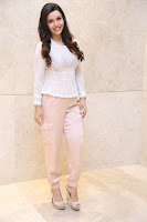 Kyra Dutt in Tight White Top Trousers at Paisa Vasool audio success meet ~  Exclusive Celebrities Galleries 034.JPG