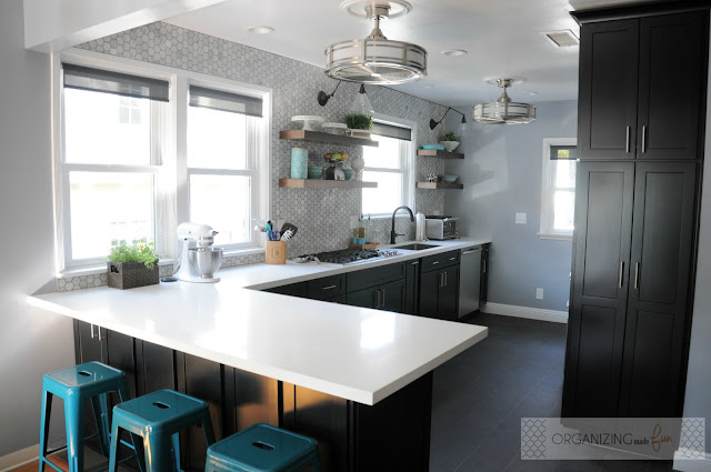 After: Amazing modern kitchen with black cabinets and white quartz counters :: OrganizingMadeFun.com