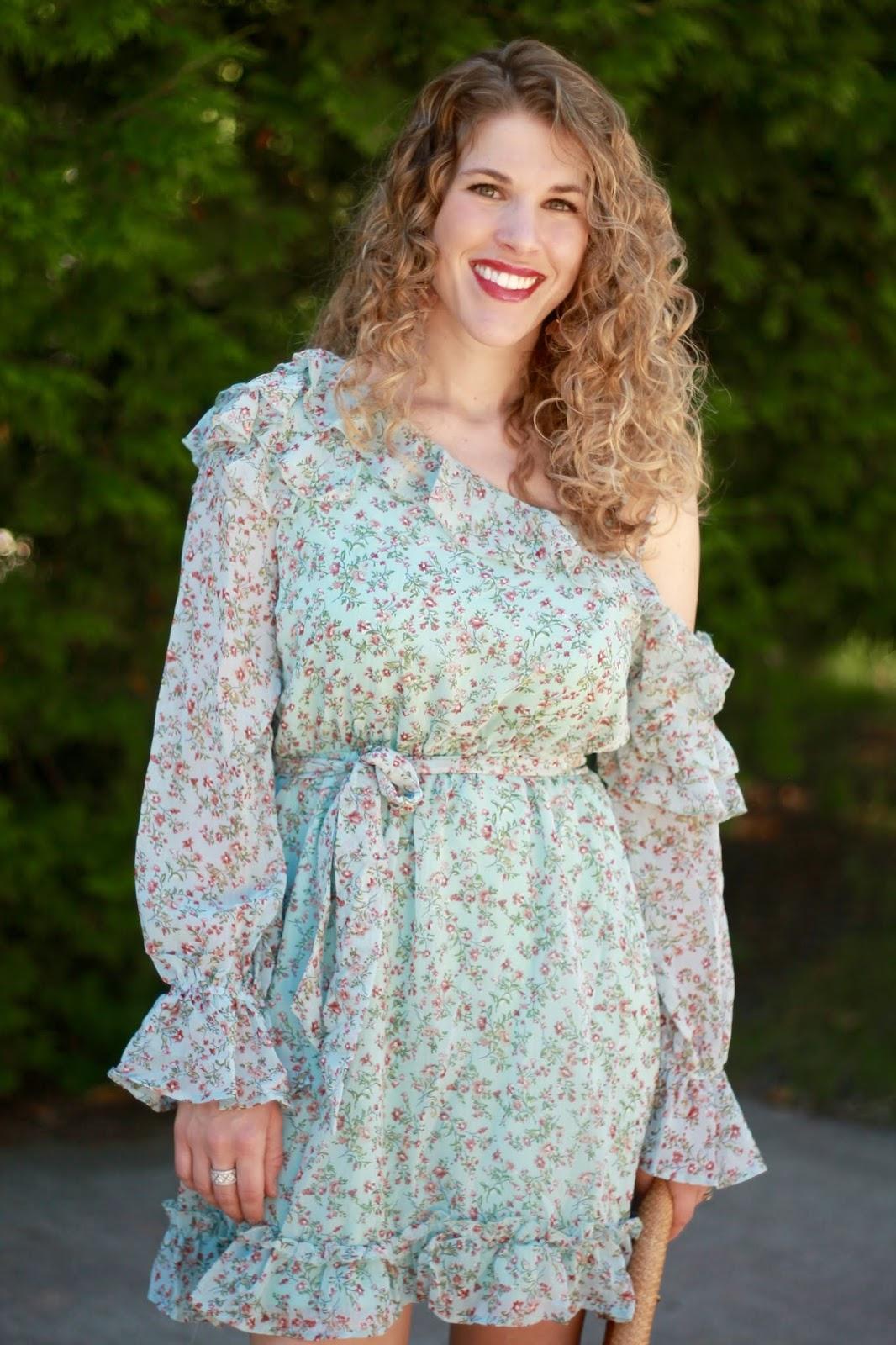 light blue floral one shoulder dress, straw clutch, blush heels