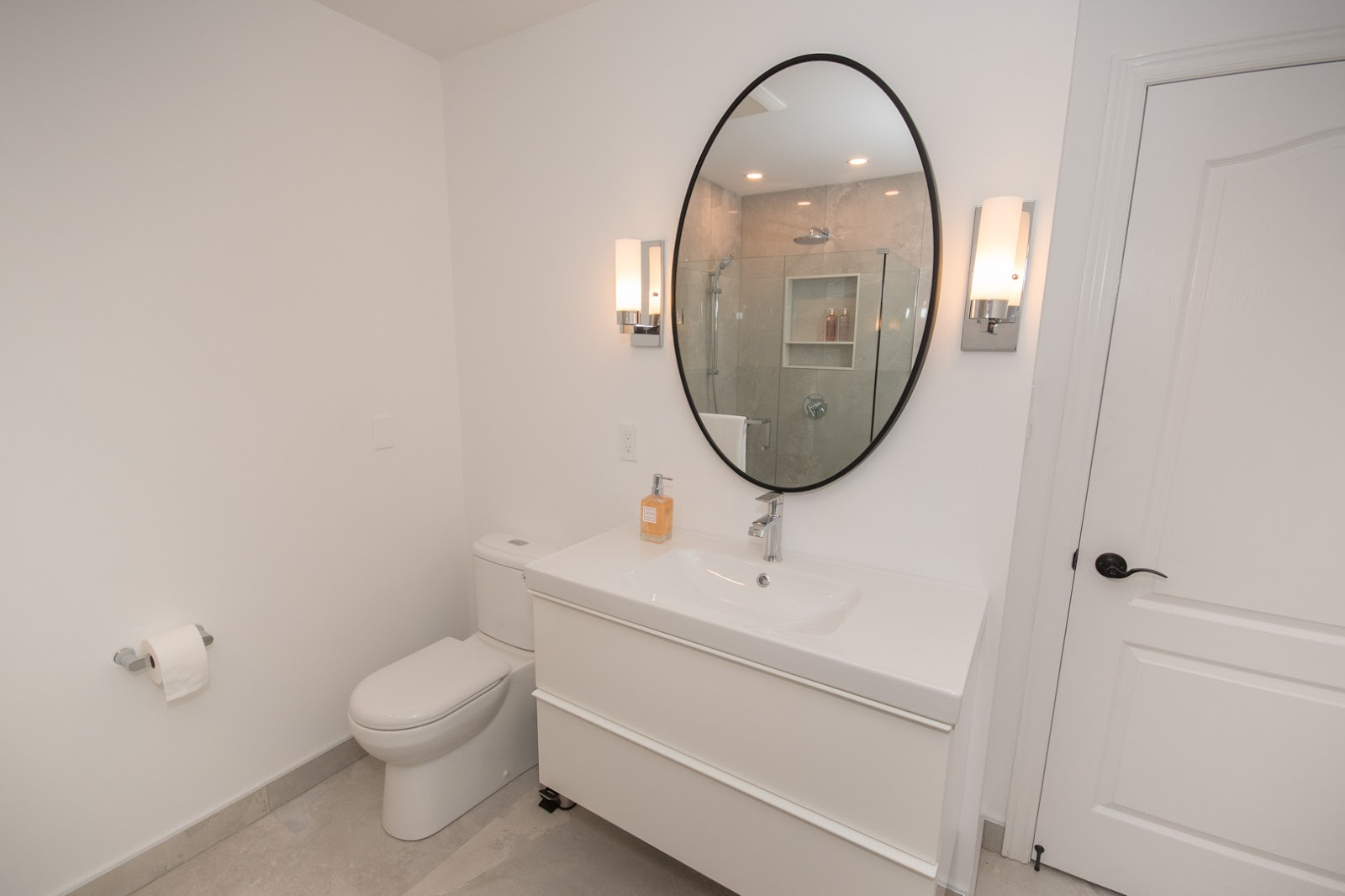 floating vanity and oval mirror