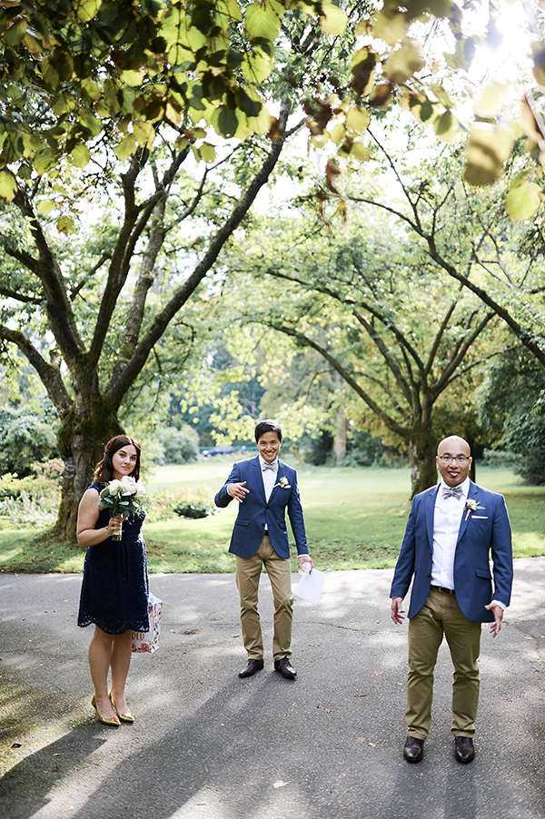 Groomsmen and bridesmaids in a blue and gold wedding