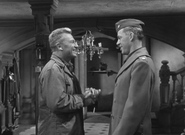 Eddie Albert shaking hands with Lee Marvin