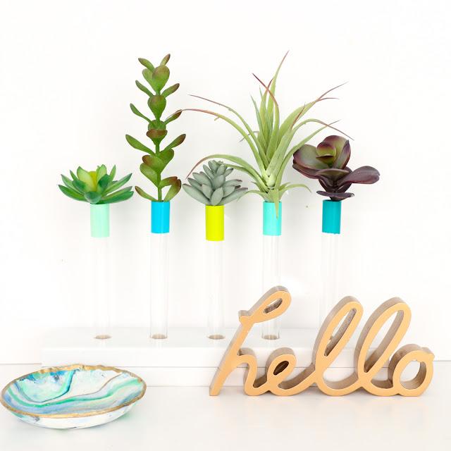 http://www.craftaholicsanonymous.net/diy-test-tube-bud-vase
