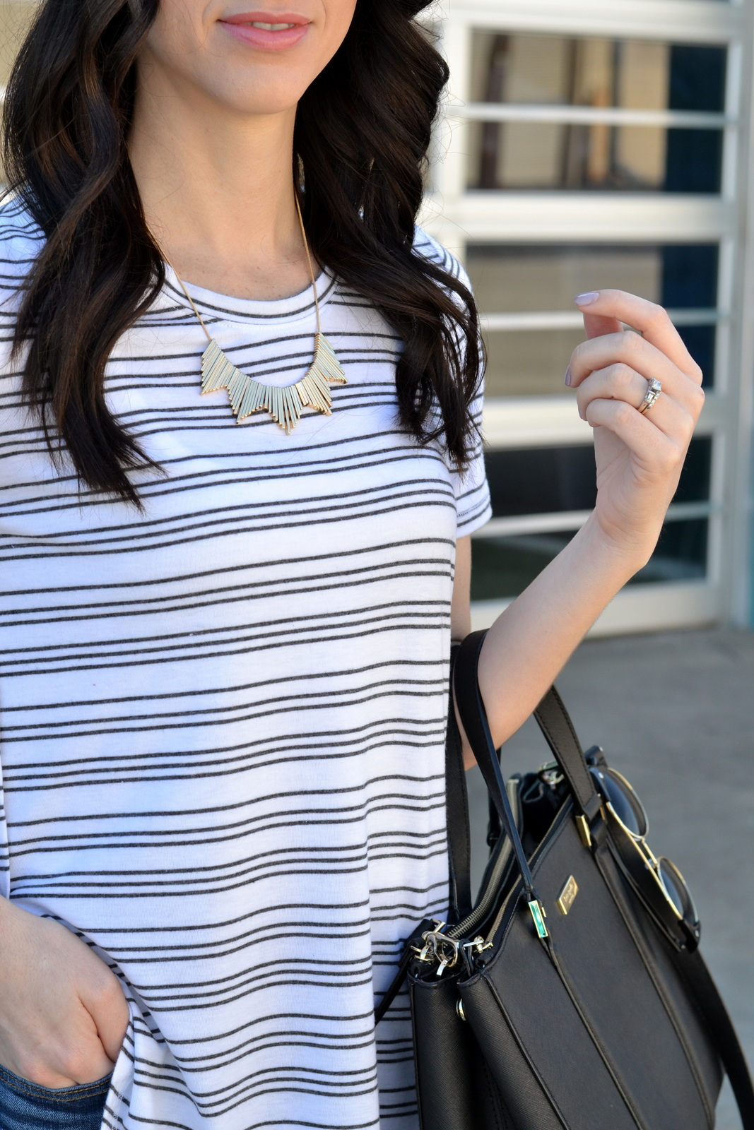 Rocksbox jewelry paired with basic tee and loose curls