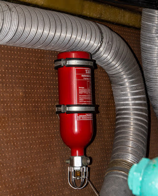 Photo of one of the automatic extinguishers in the engine room