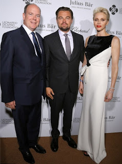Princess Charlene of Monaco at the Leonardo DiCaprio Foundation Gala 2016 in a black and white long sleepless gown with a knot detail