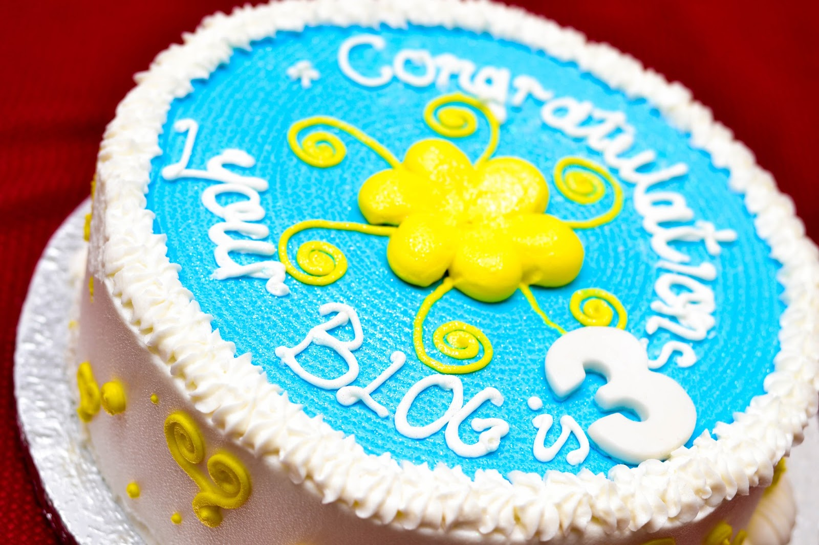 Blogversary Cake with Blue, White and Yellow Icing